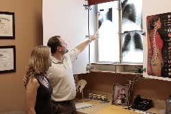 Dr. Jordan Mastronardi reviewing x-ray findings with his patient.